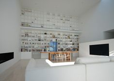 Library House | a 20-foot high floor-to-ceiling bookshelf
