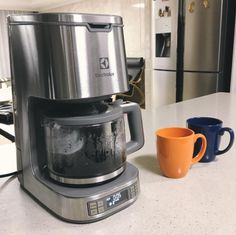 Put your mugs close to the coffee machine as it's brewing to warm them up before you pour coffee into them.