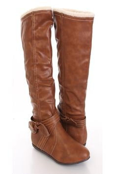 Make a fashion statement with these sexy mid calf boots! They will look super hot paired with your favorite skinnies or dress. Make sure you add these to your closet, it definitely is a must have! It features faux leather, side zipper, faux sheering trim, crisscross straps, side bow, stitched detailing, smooth lining, and cushioned footbed. Approximately 16 inch shaft and 15 inch circumference.