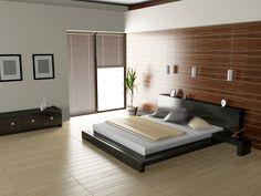 Sleek modern bedroom with light wood floor and dark frame bed