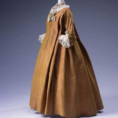 The Kyoto Costume Institute's 1720 Robe Volante dress is a loose fitting garment made with silk taffeta and is pleated on the front and back.  A rare example of this fashion, likely ca. 1720-40.