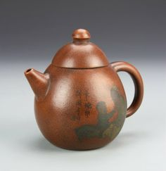 China, Yixing Zisha teapot, glazed rust red with an overall oval shape to the form, and two figures with calligraphy . on Jan 2014 Yixing Teapot, Jasmine Green Tea, Teapots And Cups, Chinese Tea, Kettles, Coffee Set, Chocolate Pots, Tea Ceremony, Plates And Bowls