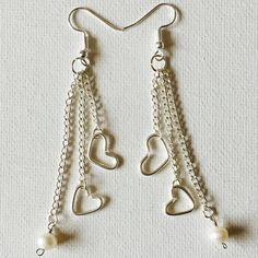 Made a pair of double silver heart and freshwater pearl charm triple silver chain dangling earrings!