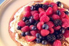Breakfast Pizza by Giada  Ingredients  1 storebought pizza dough  2 tablespoons butter, melted  4 tablespoons Cinnamon-Sugar, divided, recipe follows  2 cups mascarpone cheese  1 tablespoon heavy cream  2 tablespoons lemon juice  1 teaspoon lemon zest (from 1 lemon)  2 cups mixed berries