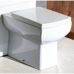 Eslick Back to Wall Toilet with Soft Close Seat Belfry Bathroom Low Level Toilet, White Toilet Seats, Traditional Toilets, Close Coupled Toilets, Concealed Cistern, Back To Wall Toilets, Toilet Sink, Wall Hung Toilet, Flat Ideas