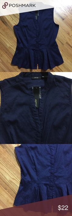 """Pretty navy blue peplum blouse, sleeveless New with tags and in perfect condition. About 16"""" across at the waist. About 18"""" across the bust, armpit to armpit. About 25"""" in length. I am a five star closet and a suggested user. Check my reviews and buy with confidence. Thank you! 😍 Apt. 9 Tops Blouses"""
