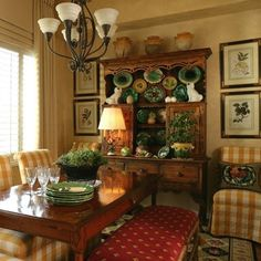 Love the hutch filled with majolica, harmonizing with the color scheme of red, gold and green
