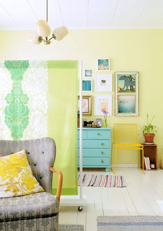 Love this idea for a fabric room divider from Ohdeedoh. I also love the color combinations and artwork layout on the wall.
