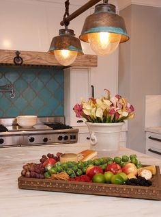 LOVE THAT LIGHT FIXTURE!---eclectic kitchen by Intimate Living Interiors
