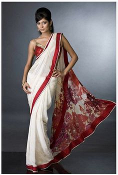 Love the alternation of colour combos here (white base saree with red detail and red base blouse with silver detail).. love it! (Utsav)
