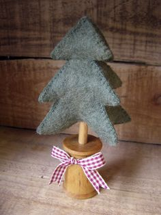 Felt little Christmas tree in spool base....tree has 4 sides which is hard to see from the picture here.