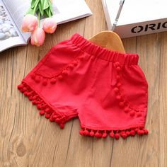 * Floral print<br /> * Tassels design<br /> * Breathable and comfy<br /> * Material: Cotton<br /> * Machine wash, tumble dry<br /> * Include: 1 top, 1 bottom<br /> * Imported Baby Girl Dress Patterns, Kids Outfits Girls, Toddler Girl Outfits, Baby Outfits Newborn, Little Girl Dresses, Toddler Girl Shorts, Baby Girl Pants, Girls Pants, Shorts For Girls