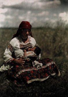 c. October 7, 1930, Sanok, Poland-- A Romany mother nurses her baby. Photographer: Hans Hildenbrand  National Geographic Society/Corbis
