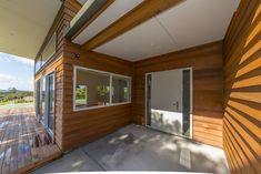 Rusticated cedar bevel back weatherboard entry