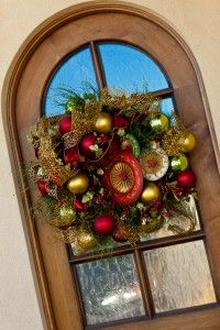 oversized ornaments compliment wreath on the Front Doorway  http://www.app.showmedecorating.com
