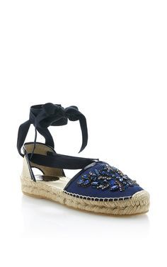 This espadrille by **Oscar de la Renta** is rendered satin and features  intricate beading, a wrap around tie at the ankle and a jute sole.