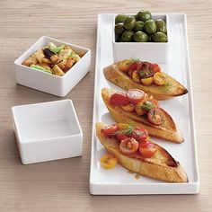 Free Shipping.  Shop bento rectangular platter.   Long slim span of white stoneware with three-quarter-inch raised rims adds simple edge from every angle.  Serve a square meal with Bento dinnerware.