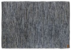 """""""Rock'n'jeans"""" is hand woven chindi rag rug carpet made from excess materials from the fashion industry in India, (leather & denim). Sustainable and beautiful decor."""