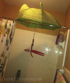 Elf under umbrella.