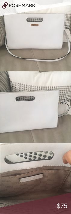 """Clutch Purse By Michael Kors Size: 17"""" X 11"""" X 1 3/4"""" . All White Envelope purse with strap. Functional interior. Includes card holder pockets and phone pocket.  Excellent condition. Very unnoticeable scuffs. Bags Clutches & Wristlets"""