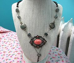 Assemblage Necklace, Vintage Peach And Gray Necklace, Vintage Black Rosary Assemblage, Skeleton Key Necklace, Upcycled Assemblage Jewelry : This assemblage necklace has a large peach faux stone and silver-tone vintage flowered brooch (with its pin removed and filed smooth) as its focal point. I have always loved the color combination of peach and gray so I combined the former brooch with upcycled milky gray glass faceted beads, gray pyrite lentil beads and the absolute best vintage crys...