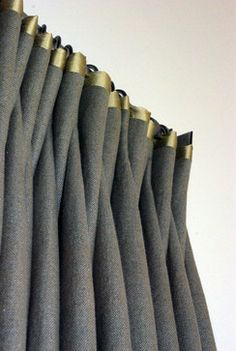 Love the contrast - grey drapes with green/gold trim.