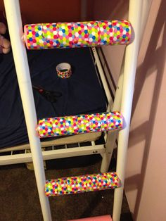 on a metal bunk bed ladder, cover with a pool noodle and wrap with decorative duck tape