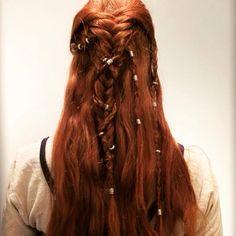 Braids, beads, and wavy hair
