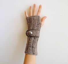 Fingerless gloves with buttoned strap pattern on Craftsy.com $4.90