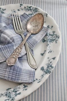 How perfect...blue & white plaid napkin with old silver on lovely old ironstone ware and a tiny checked patterned table cloth. Sigh!