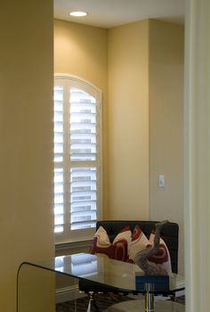 No matter the shape or size, we love plantation shutters! What a cute little office space!