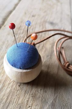 This beautifully presented gift set from Cohana includes a sweet wooden pincushion that can be worn around the neck, alongside a set of three hand made glass marking pins. #BeyondMeasure #sewing #japanese #wooden Pincushions, Glass Beads, Weaving, Japanese, Sweet, Fabric, Handmade, Gifts, Candy