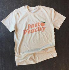 Vintage-Inspired Just Peachy T-Shirt Georgia Peach - Inspirational T Shirts - Ideas of Inspirational T Shirts - Vintage-Inspired Just Peachy T-Shirt Georgia Peach Cute Tshirts, Cool Shirts, Tee Shirts, Aesthetic T Shirts, Aesthetic Clothes, Camisa Vintage, Peach Shirt, Just Peachy, Vintage Shirts
