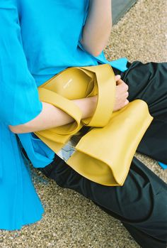 Contemporary accessories brand Death In Paris' Spring 2016 Collection from handbags to clutches with transparent details in mustard and classic black.