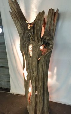 Our work is always unique! That's the nature of working with driftwood as a medium. But this piece absolutely takes the cake! A hollow, but incredibly solid driftwood tree trunk that has some beautiful lines. We're obsessed! A custom fabricated light fixture is securely mounted inside