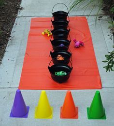 Halloween Carnival Game Idea -- Witches Brew!! Super easy to set up and fun for kids! from CarnivalSavers