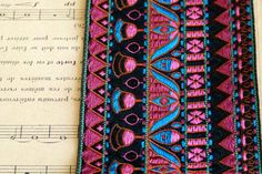Wonderful vibrant jacquard rayon trim.    This trim is new old stock and was created in St. Etienne, the world home of ribbon making, in the