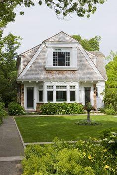 Shingled cottage.