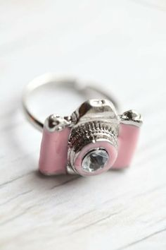 Pink camera ring :) so cute - so where can i get one of these? it would make for a GREAT gift for my photographer friend