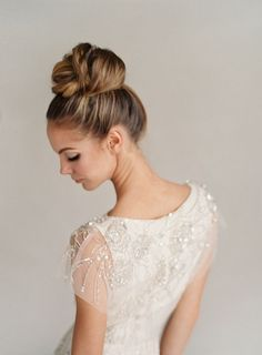 Top knot wedding hairstyle & Jenny Packham Rose Wedding Dress