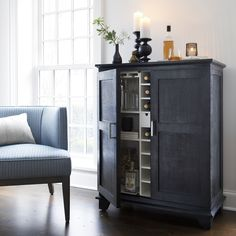 Wire-brushed rustic and stained a deep shade of charcoal black, this solid wood bar cabinet exudes an Old World feeling that belies its fresh white interior. Stocked with storage for barware and bottles, Grantham plays the perfect host.