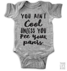 You ain't cool unless you pee your pants!  White Onesies are 100% cotton. Heather Grey Onesies are 90% cotton, 10% polyester. All shirts are printed in the US