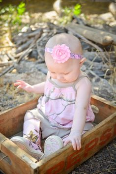 Let daddy or mommy show how much they love to hunt with this cute Realtree pink camo headband!