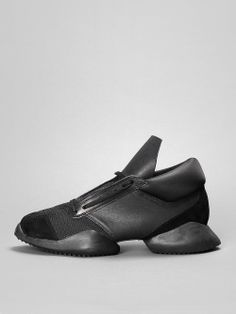 #musthave RICK OWENS X ADIDAS Rick Owens x Adidas sneakers in black nylon and leather details with two separated soles. The body is made in nylon and details in cow leather, while the sole is rubber. #rickowens #adidas