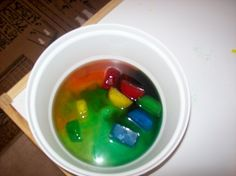 Science: Water play with colored ice cubes. Sensory activity, color mixing.