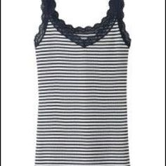 Uniqlo Striped Tank! Excellent condition, only worn and washed (and air-dried, no dryer for Uniqlo gear!!) twice. It's Navy and white, with subtle glittery strips between the contrasty stripes. The Navy blue is quite dark, it could 'read' as black and white. UNIQLO Tops Tank Tops