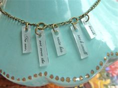 "e.e. cummings poem necklace: ""No one, not even the rain, has such small hands."""