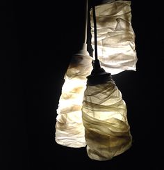 Fabric wrapped clustered pendant lights