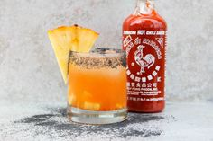 Pineapple and Sriracha Margarita - The Margarita today is an example of how many flavors can be combined together to make a balanced cocktail. The sweetness from the pineapple juice really balances out the spicy. I rimmed the glass with a black lava salt to add an additional salty flavor and a fun color. Do you want to spice up your cocktail life?