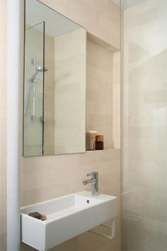 Architect Visit: Instant Bath Remodel by Uniform Design Remodelista. Frameless shower door, narrow but long sink creates illusion of space. Bathroom Color Schemes, Bathroom Colors, Bathroom Ideas, Basement Bathroom, Basement Inspiration, Bathroom Inspiration, Ikea Sinks, Recessed Shelves, Tiny Bath